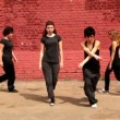 Four girls start to dance synchronously but one of them make mistake and they laught — Stock Video #28845141