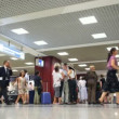 People with bags expecting boarding inside Leonardo dVinci-Fiumicino Airport — Stock video #28845171