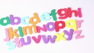 Multicolored letters arranged in three lines — Stock Video