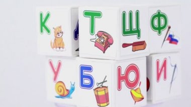 Some cubes with letters and images on it — Stock Video