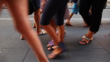 People legs in summer shoes and stroller walk on sidewalk in sunny day — Stock Video
