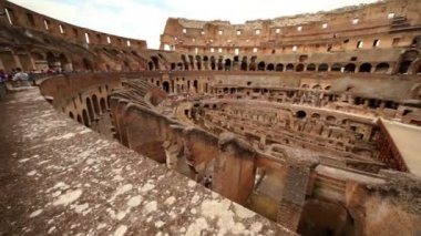 Colosseum arena area and the tunnels under it, walls divide walkway around arena — Stock Video