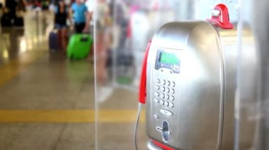 Telephone apparatus weighs in airport people walk around — Stock Video