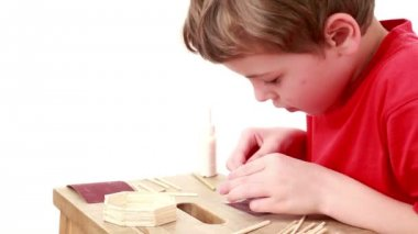 Boy whet match using sandpaper which lies on table for this — Stock Video