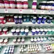 Many cans of paint are on shelves in store — Stock Video #29827919