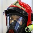 Protective suit with helmet, gas mask and manometer for fireman — Stock Video