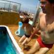 Son with father jump in pool on cruise ship — Stock Video