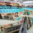 Many peoples move on escalators in multiple floors shopping center — Stock Video