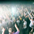 People jump hands up at rave party in large hall — Stock Video #29828325