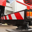 Stock Video: Foot of support of fire-engine with light alarm system side view