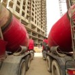 Concrete mixer stand near unfinished buildings — Stock Video
