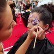 Professional visagiste makes body art at XVII International Festival World of Beauty 2010 — Stock Video