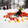 Boy and little girl play in pile of colored balls in park — Stock Video