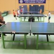 Number of table tennis and children playing in gym — Stock Video