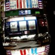 Man presses button on slot machine — Stock Video