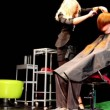 Stock Video: Hair stylist EugeniSobolevmakes hairstyle for mat Davines Hair Show