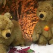 Stock Video: Couple moving plush toy bears on artificial snow beside cavern