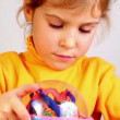 Stock Video: Little girl play with three-dimensional toy puzzle