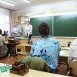 Several adult females sitting at meeting in classroom of school — Stock Video