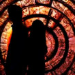 Stock Video: Silhouette couple who had their backs to each other in fabulous decoration tunnel