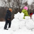 Mother and father with children play snowballs behind fortress, part2 — Stock Video