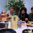 Family and many children with guests sit around table, celebrating birthday party — Stock Video