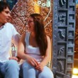 Couple sits nicely talking on background of Egyptian scenery — Stock Video