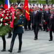 Moscow mayor Sergei Sobyanin walk behind of soldiers carry garland on wreath laying ceremony — Stock Video