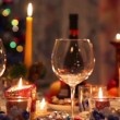 Christmas dining table with bottle, glasses, candy, candles — Stock Video #29829539