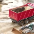 Empty tipper truck leaving from construction site — Stock Video #29829681