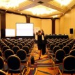 Stock Video: People walk in empty conference hall during break