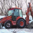 Bulldozer boring terrestrial rocks in winter — Видео