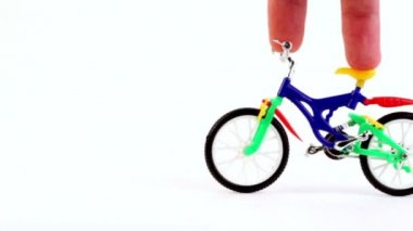 Fingers ride on toy bike, then other fingers came on fingerboard — Vídeo Stock