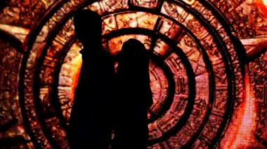 Silhouette couple who had their backs to each other in fabulous decoration tunnel — Stock Video