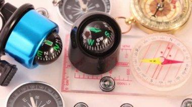 Twelve different multi-colored compasses — Stock Video