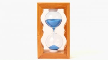 Sand pours inside hourglass measured time — Stock Video