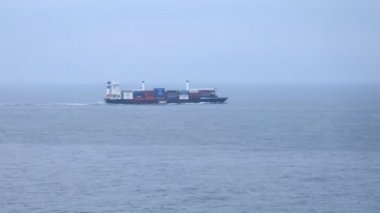 Lonely freight ship in open sea, time lapse — Stock Video