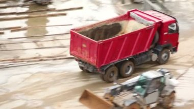 Empty tipper truck leaving from construction site — Stock Video