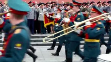 Interior Ministry officials salute, military orchestra play and march at foreground — Stock Video