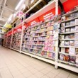Showcase with dvd discs with varius films in hypermarket Auchan — Video