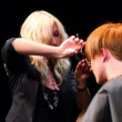 Stock Video: Hairdresser EvgeniSobolevdo haircut for mat Davines Hair Show 2010