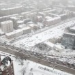 Stock Video: Houses and street traffic on Sadovoye Koltso in Moscow at winter
