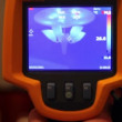 Stock Video: Hand hold thermal image camera, on-screen chandelier on ceiling