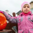 Little girl chewes candy, pumpkin of Halloween — Stock Video