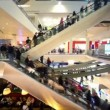 Many people move on escalators in multiple floors shopping center Atrium — 图库视频影像