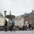 People relax in front of Gammeltorv fountain — Stock Video