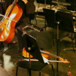Violoncello on which is played by musician in theatrical pew — Stock Video