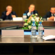 Unfocused men in business suit sit at the table on conference — Stock Video