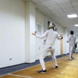 Boy and girl fence with swords on special carpet — Vídeo de stock