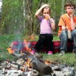 Boy and little girl sit, they drink juice and watch at bonfire — Stock Video